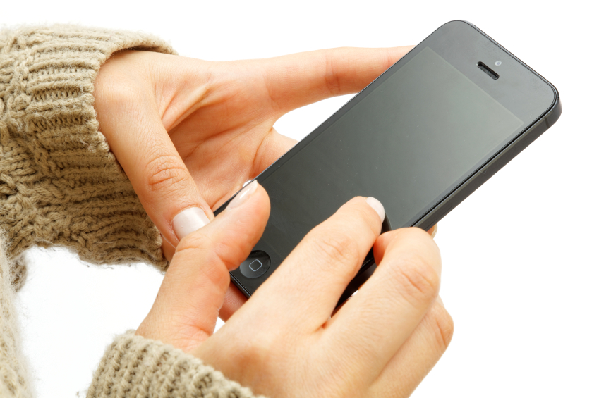 hands of iphone 5 being used