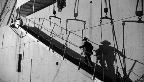 "CC. ""Man on ship's gangplank,"" by James Crookall"