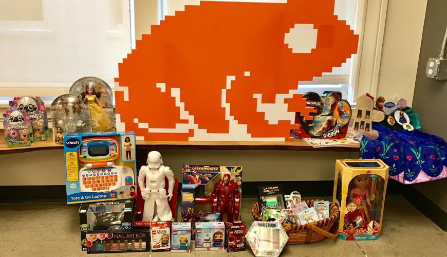Our Giving Toad sourronded with donations for our winter charity drive