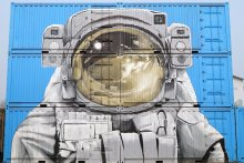 Shipping Containers with Spacesuit Graffiti